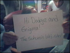 "My handwriting, and Erin's holding the sign.  Another person ICQ-ed me with a request, and so we said okay.  Only one thing we changed... they wanted us to say ""Spinnwebe"", but we decided to say ""The Schumin Web""."
